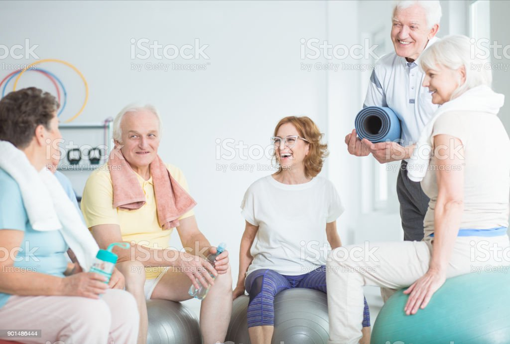 Happy Seniors On Gym Balls Stock Photo & More Pictures of Adults Only