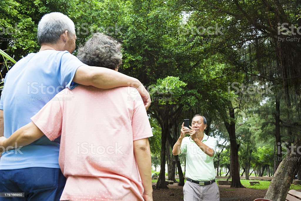 happy seniors taking picture by smart phone in the travel stock photo