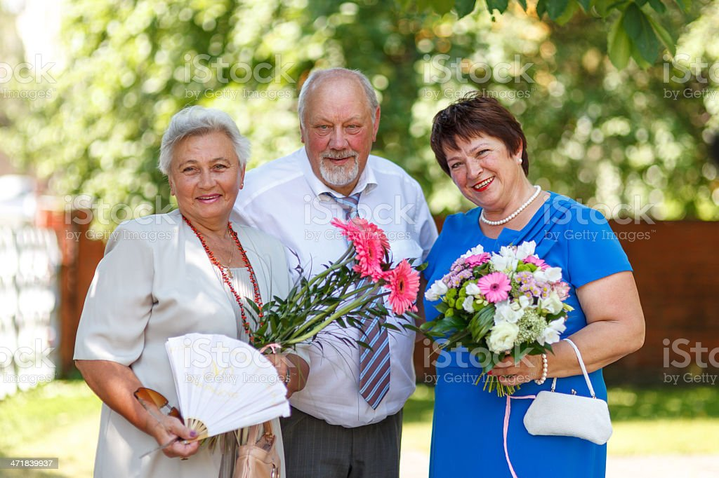 Happy seniors with flowers royalty-free stock photo
