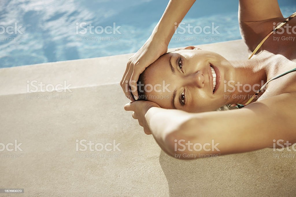 Happy sexy woman relaxing by the swimming pool royalty-free stock photo