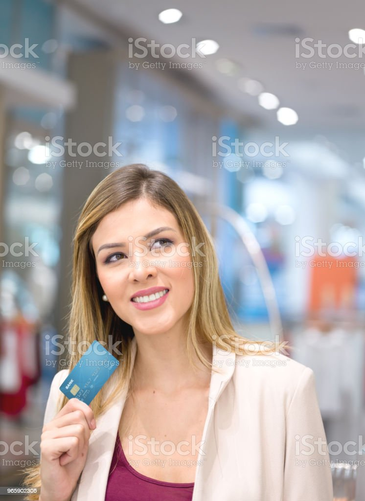Happy shopping woman holding a credit card - Royalty-free Adult Stock Photo