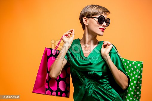 istock Happy shopping woman with shoping bags 925420308