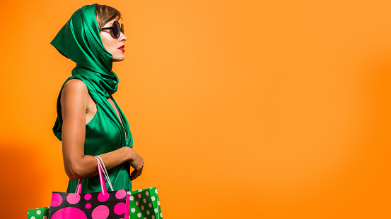 istock Happy shopping woman with shoping bags 925420414
