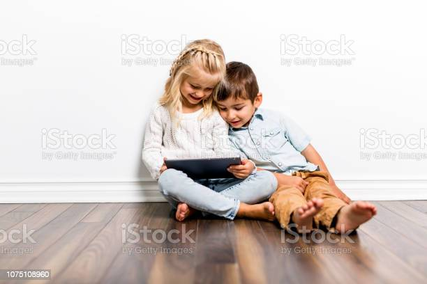 Happy siblings child playing with pc tablet together picture id1075108960?b=1&k=6&m=1075108960&s=612x612&h=pvvxfmkmvu0fkrfug64ia5blxdqswgyqjzmhcmntjhe=