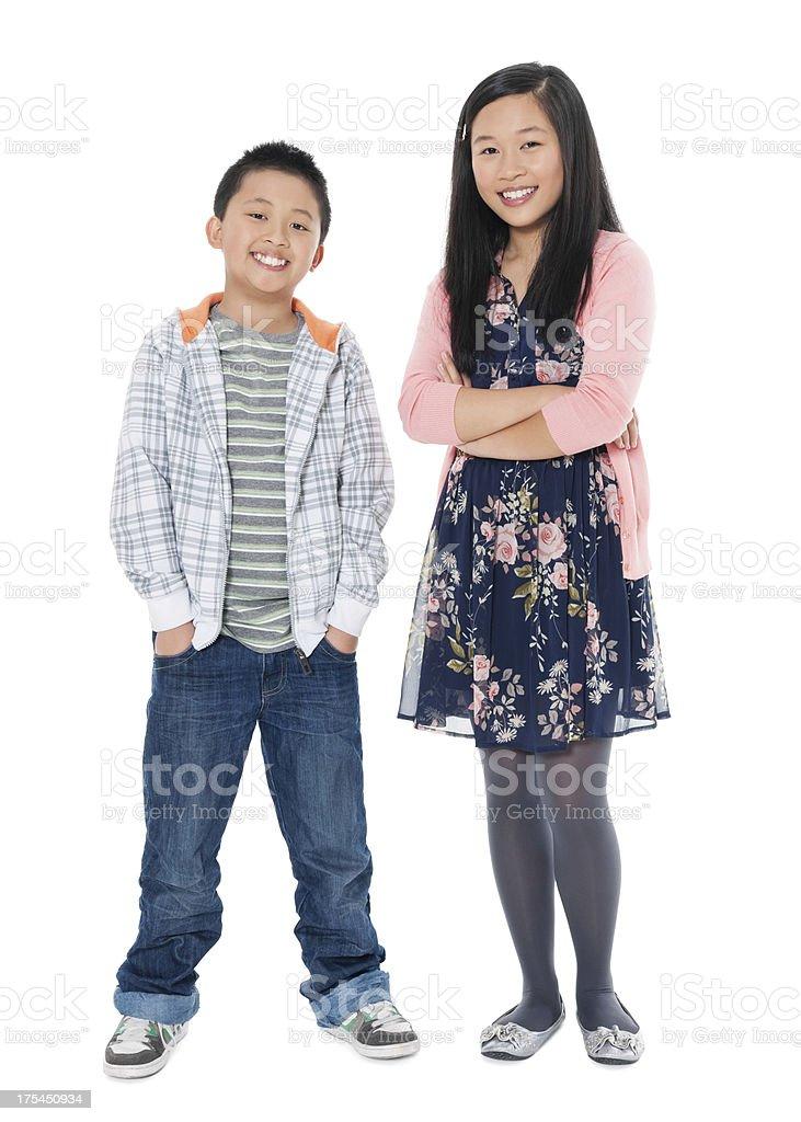 Happy Siblings In Casual Wear stock photo