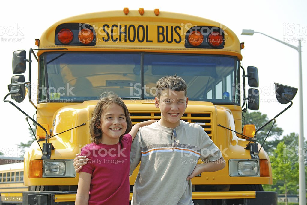 Happy Siblings In Front of Bus royalty-free stock photo