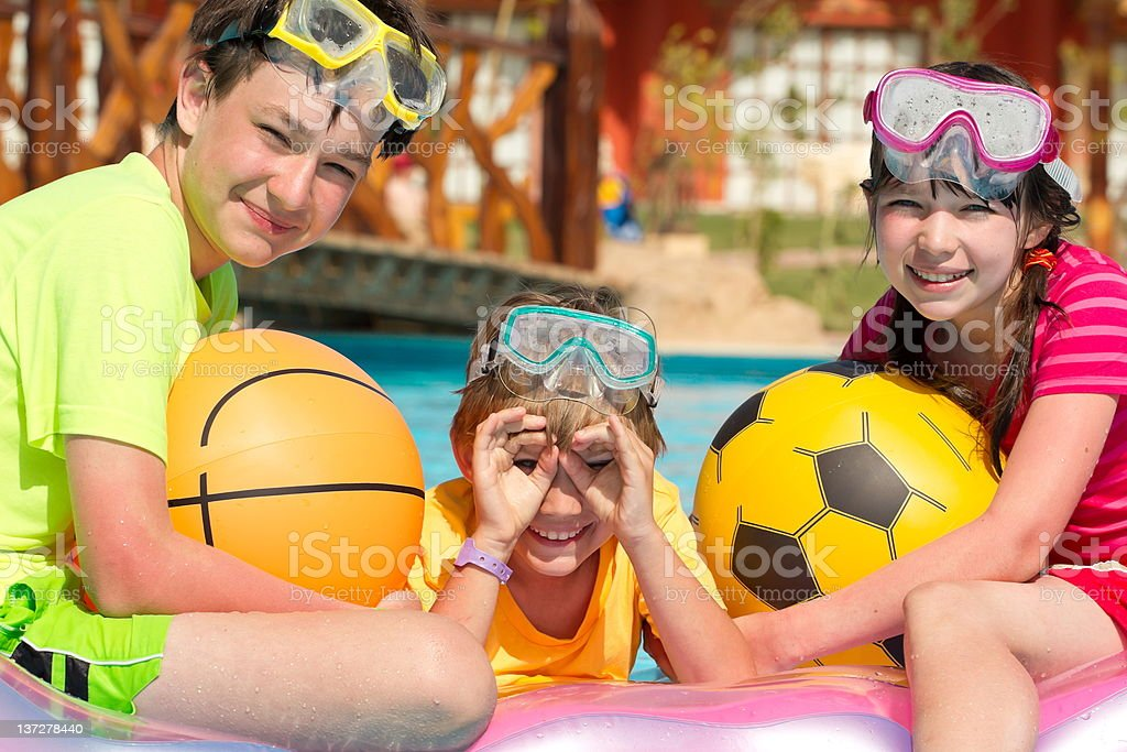 Happy siblings in the pool royalty-free stock photo