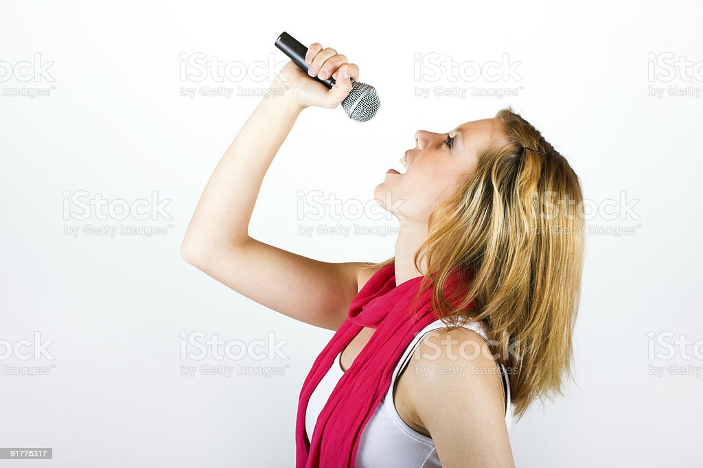 happy singing woman with a microphone royalty-free stock photo