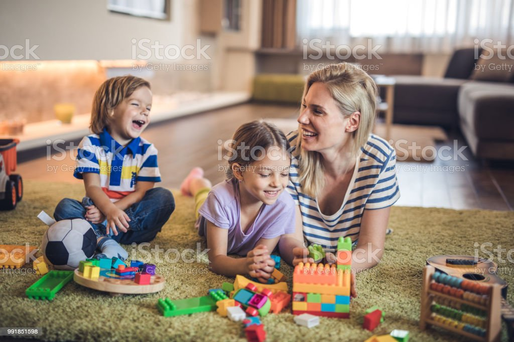 Happy Single Mother Playing With Her Small Children In The ...