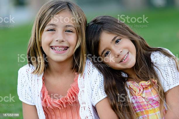 Happy Sisters At The Park Stock Photo - Download Image Now