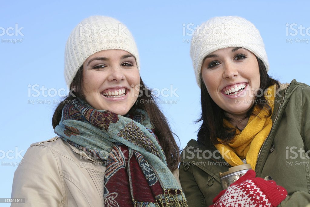 Happy Sisters at Winter Time royalty-free stock photo