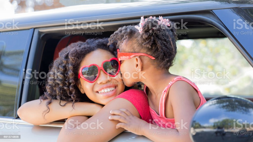 Happy sisters or friends on a Summer Joy Ride stock photo