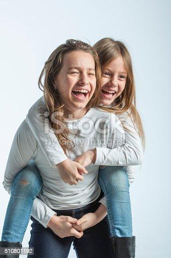 585604690 istock photo Happy sisters 510801192