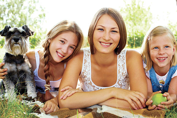 Happy sisters resting summer in the park stock photo