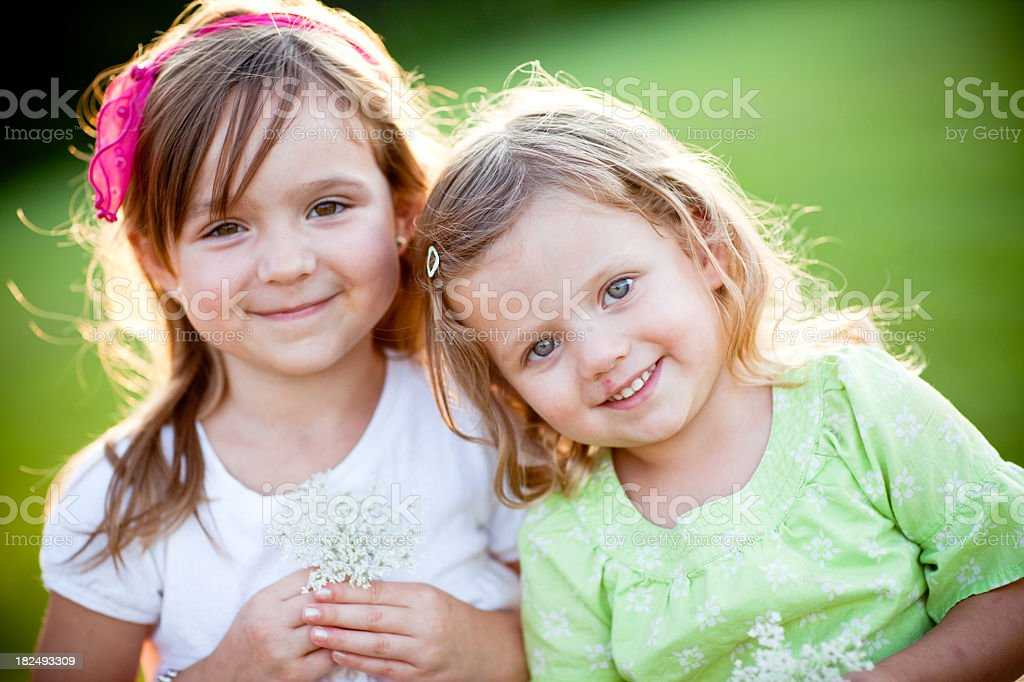 Happy Sisters Smiling Together Outside royalty-free stock photo