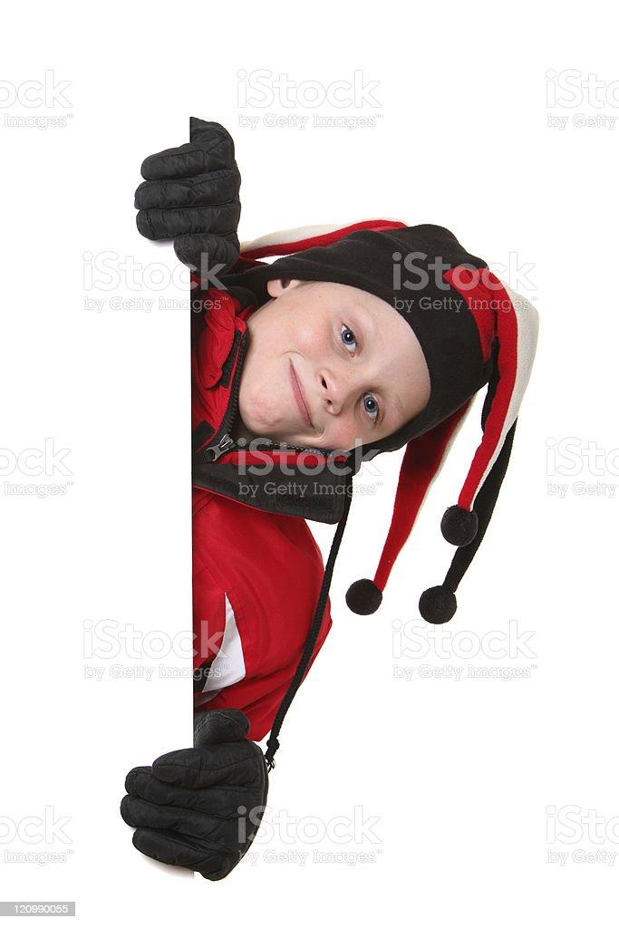 happy ski kid peeking royalty-free stock photo