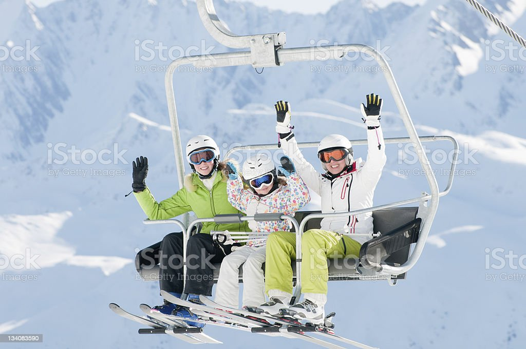 Happy ski vacation stock photo