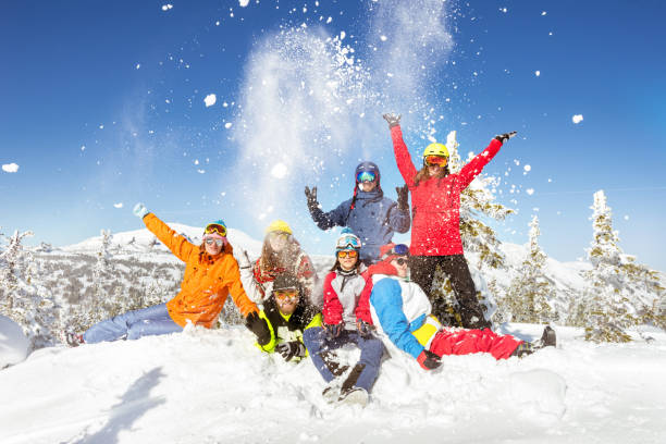 Happy skiers and snowboarders winter vacations Happy skiers and snowboarders having fun at ski resort. Winter vacations concept ski stock pictures, royalty-free photos & images