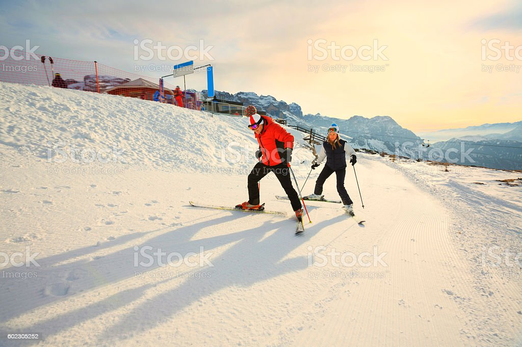 Happy skiers, best friends, Madonna di Campiglio ski resort stock photo