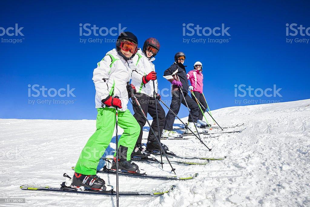 Happy skiers on top of ski resort royalty-free stock photo
