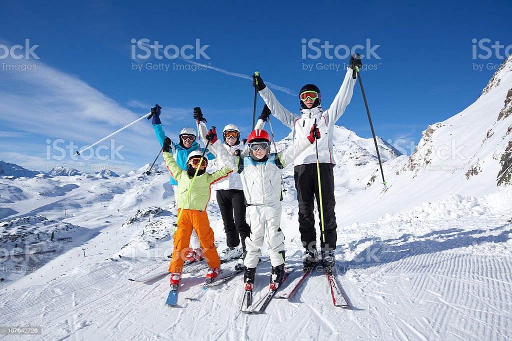 happy skiing group in mountains royalty-free stock photo