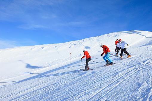 Happy skiing group  Ski school  Beautiful mountain landscape background