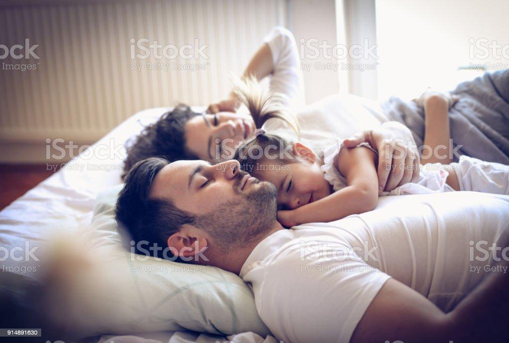 Happy sleepy family. stock photo