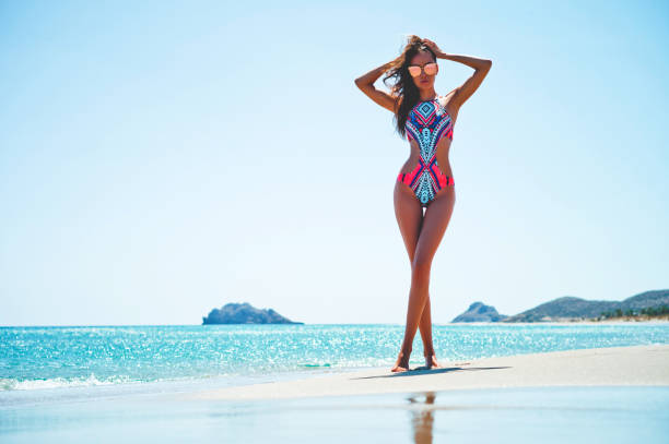 Happy slender woman at sea stock photo