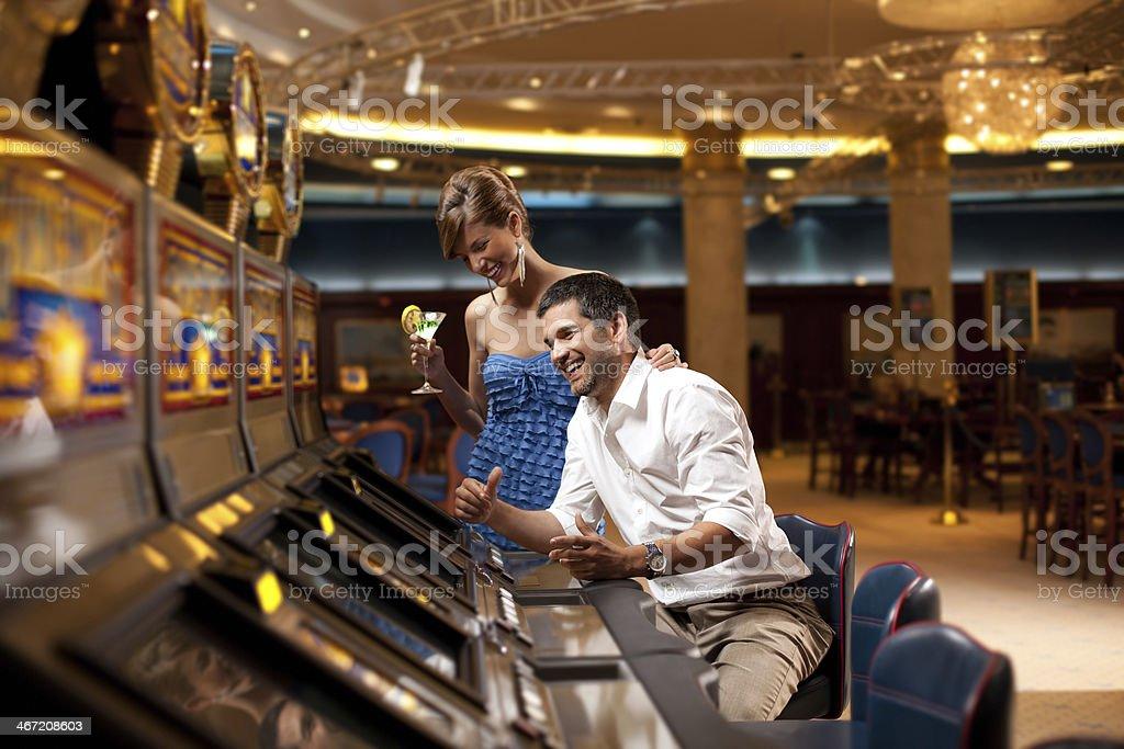 happy slot machine playing stock photo