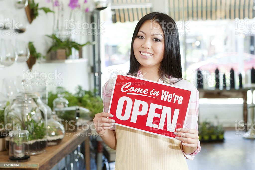Happy Small Business Retail Store Owner with OPEN Sign Hz royalty-free stock photo