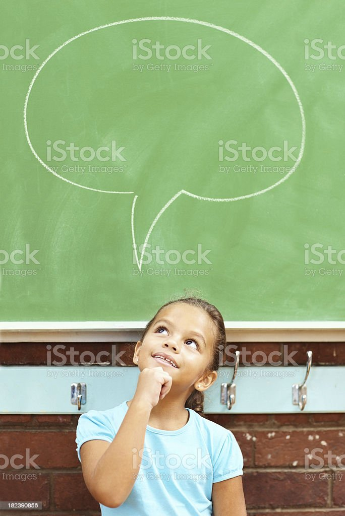 Happy small girl having a thought bubble royalty-free stock photo