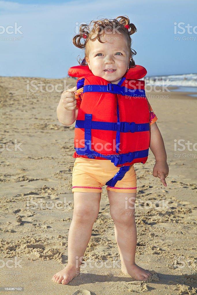 Happy small girl on the beach (XXXL) stock photo