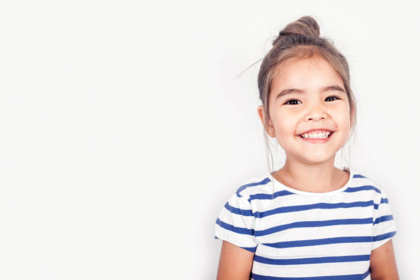 happy small girl - toothy smile stock photos and pictures