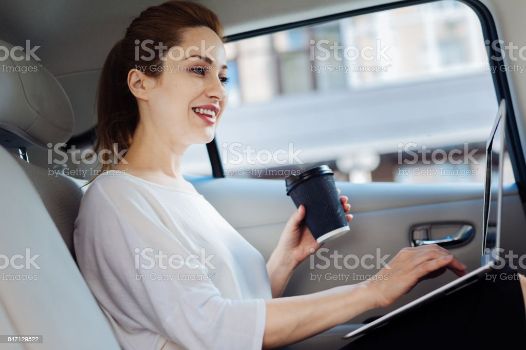 Happy smart businesswoman working on a laptop stock photo
