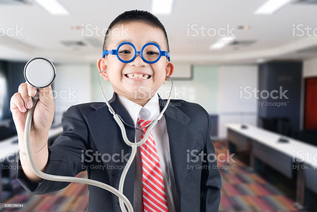 Happy smile little business boy in conference hall background royalty-free stock photo