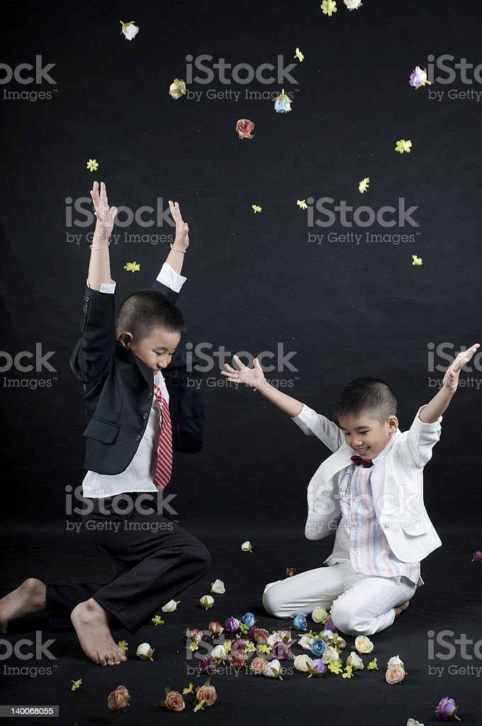Happy smile little business boy with flower royalty-free stock photo
