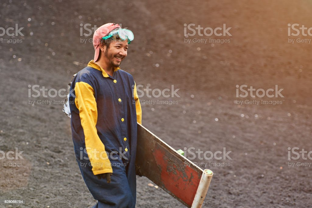 Happy smile man after volcano boarding stock photo
