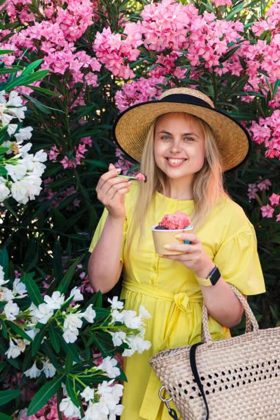 Happy smile woman eat and enjoy ice cream stock photo