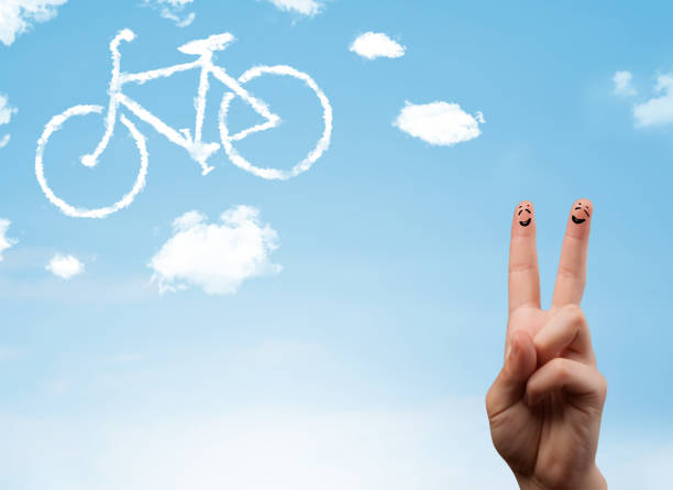 happy smiley fingers looking at a bicycle shapeed cloud - bike emoji imagens e fotografias de stock