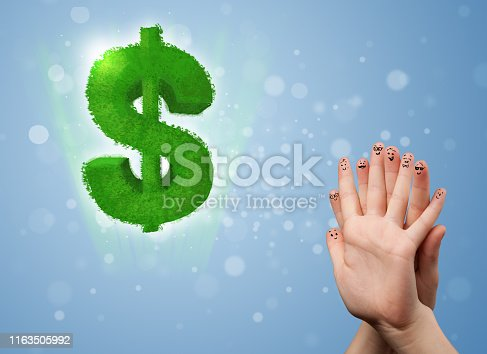 Happy cheerful smiley fingers looking at green leaf dollar sign
