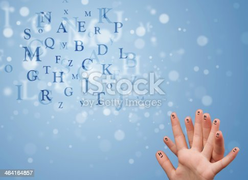 istock Happy smiley fingers looking at mixture of bokeh letters 464164857