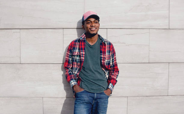 d6c03d78f0 Top Cool Young Black Man Posing In Checkered Shirt And Hat Stock ...