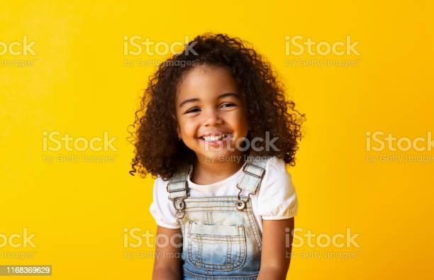 Happy smiling africanamerican child girl yellow background picture id1168369629?b=1&k=6&m=1168369629&s=612x612&h=5yi6caqnpgtqqernhtbsjlbngjdqyo2lpovgmblvexw=