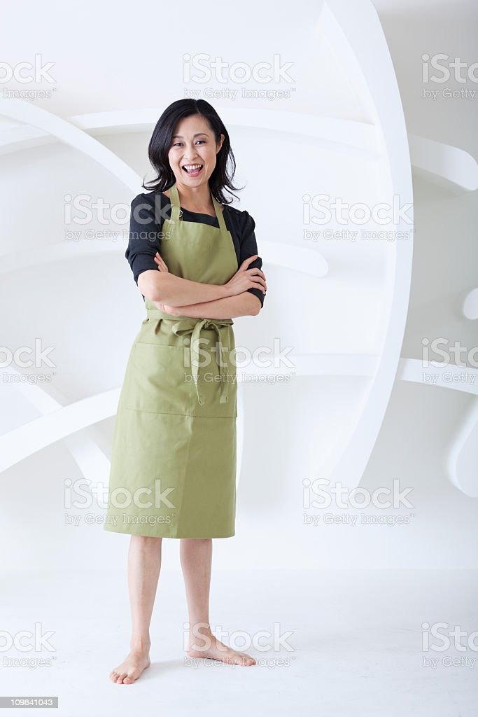 Happy Smiling and Proud Japanese Housewife with Arms Folded stock photo
