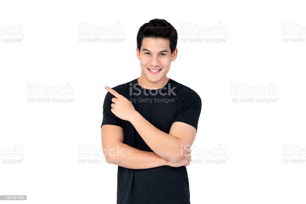 Glücklich lächelnd asiatischer Mann zeigenden Hand, leeren Raum zur Seite – Foto