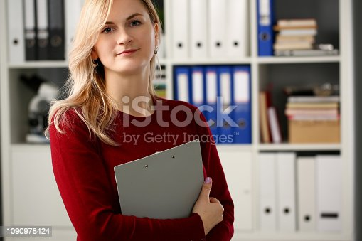 istock Happy smiling blond businesswoman holdig 1090978424