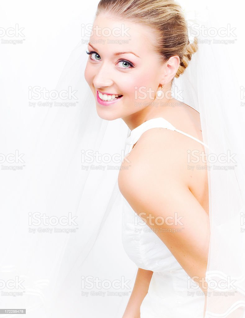 Happy smiling blonde bride from the side royalty-free stock photo