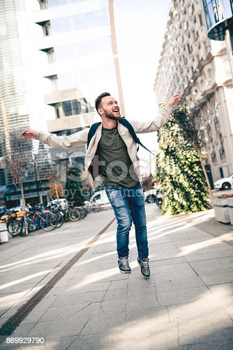 istock Happy Smiling Boy in Happy Mode Walking Toward the School 869929790