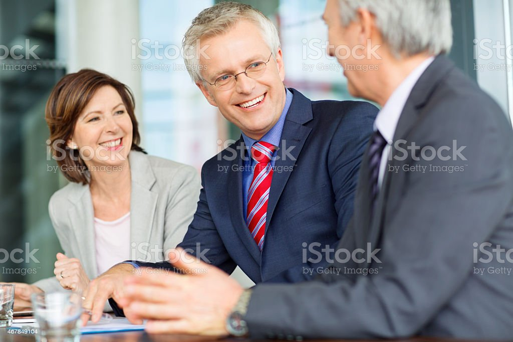 Happy smiling business man during a meeting royalty-free stock photo