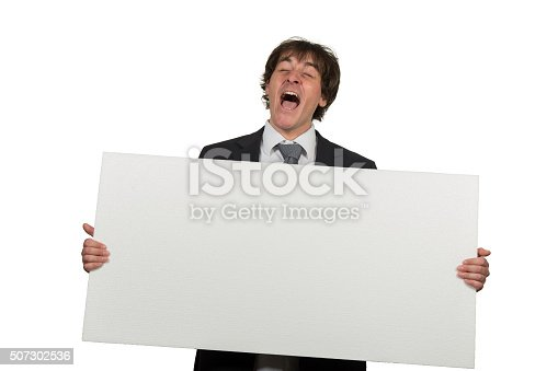 istock Happy smiling business man showing blank signboard 507302536